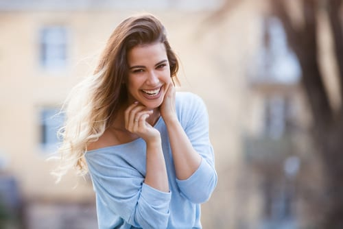 Outdoors portrait of beautiful young girl laughing-img-blog
