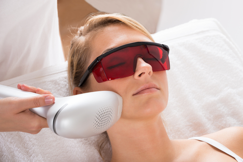 young woman undergoing laser treatment at salon-img-blog