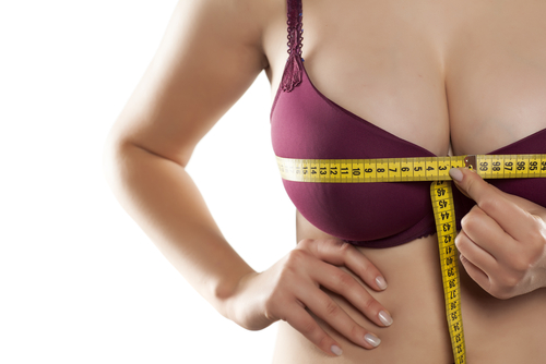 woman measured her huge breast with a measuring tape-img-blog